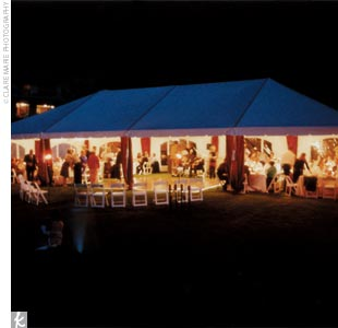 A cocktail tent lit with brightly colored lanterns housed a bar and plenty of tables for guests to mingle while Sonya and Matt had pictures taken down by the water. Later, a larger tent covered with brown silk dupioni welcomed guests with a dance floor, Brazilian guitarist, and DJ.