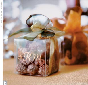 The favors were small monogrammed boxes tied with burnt-orange ribbon and filled with chocolates.