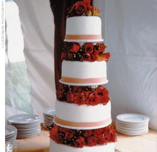 The fondant confection covered in orange roses featured two tiers of chocolate mocha, and two filled with champagne and delicious raspberry cream.