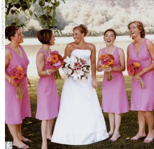 """I had five bridesmaids of all shapes and sizes,"" says Tara. ""We found great magenta linen dresses from Ann Taylor Loft. We were able to find all the sizes we needed between two local Ann Taylor stores and didn't have to order any!"""