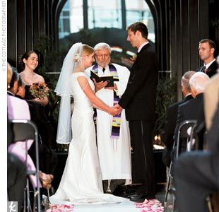 The nighttime ceremony and reception took place at Court In The Square, a grand glass-covered atrium nestled between two historic buildings.