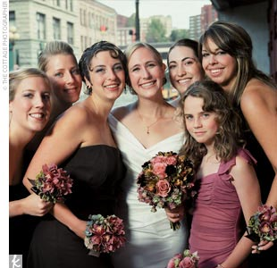 The five bridesmaids wore strapless, chocolate-brown, tea-length dresses with empire waists by Dessy Collection.