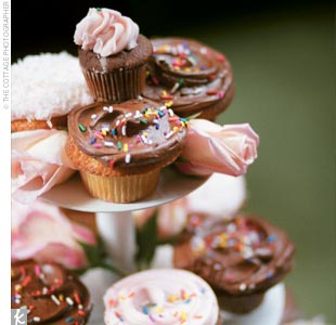 "Instead of a traditional cake, the couple opted for dozens of cupcakes frosted in the wedding's rich colors. The cupcakes were ""big and delicious,"" Willi declares."