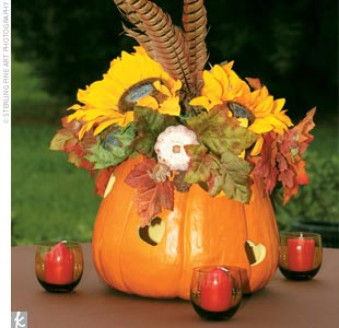Ki's mother, stepfather, and a family friend created flower-filled pumpkin centerpieces for the guest tables, and dozens of apple red candles set a romantic mood.