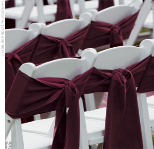 Guest chairs were tied with rich brown sashes, which coordinated with the deep chocolate sashes that accented the apple red bridesmaid dresses.