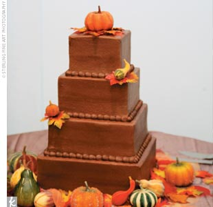 Even the wedding cake paid homage to the season. The chocolate iced confection, with tiers of red velvet, banana nut, and white almond, was decorated with tiny pumpkins, baby squash, and autumn leaves.