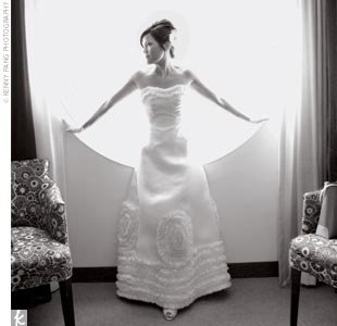 The bride's wedding gown was a strapless style with an A-line skirt embellished with ruffles and concentric circles. Twyla also donned short fishnet gloves from the '60s, something borrowed from her mom, and a short fishnet veil that she wore a little askew, making for a chic style statement.
