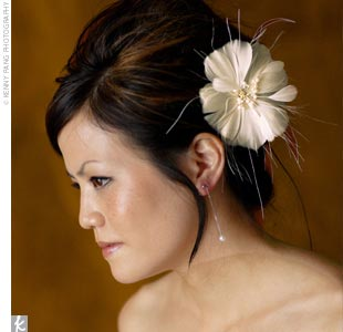 Leah C. Couture Millinery created Twyla's veil and feather flower adornment.
