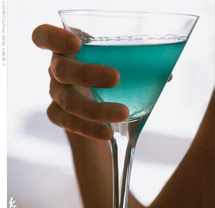 "As everyone settled in for a sit-down meal, guests sipped blue James Bond-inspired ""Q"" martinis and toasted the happy couple with blue champagne."