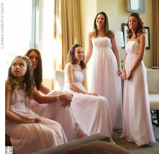 Just like Aguilera's bridesmaids, Jessika's attendants look ultra stylish and feminine in blush-colored, chiffon gowns by Jim Hjelm Occasions. Spaghetti straps and an Empire waist detail create a sexy yet sophisticated look.