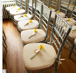 Even Jessika and Michael&#39;s seating is celeb-worthy. The icy chiavari chairs feature steel metal frames and clear Lucite details, which reflect the candlelit glow and rich colors present in the room. A single daffodil is placed on each seat, which Jessika had collected from the American Cancer Society&#39;s annual fundraiser, &quot;Daffodil Days,&quot; to represe ...