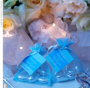 Jessika and Michael's guests receive foil-wrapped Jordan almonds in honor of the bride's Italian heritage. Five almonds are tucked inside tulle pouches to signify five wishes for the bride and groom: health, wealth, happiness, fertility, and longevity.