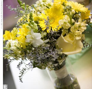The couple hired a local florist to create the wedding-day arrangements. The bridesmaid bouquets were hand-tied bunches of yellow and white blooms.