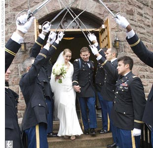 """Ian wanted a military wedding, complete with uniforms, sabers, and military cadences,"" Sarah says. The couple made their exit from the church beneath an arch of sabers."