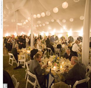 Dinner and dancing went on in a tent on the front lawn of the Hart House. Small ivory paper lanterns and soft ivory fabric added a warm feel to the reception space.