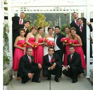 Each of Amy's five bridesmaids wore strapless tea-length dresses in fuchsia by Bari Jay. Instead of using the original fuchsia belts, Amy found tangerine ones so that the girls perfectly matched her orange and pink color scheme. Charles groomsmen wore black Calvin Klein tuxes, with white shirts and fuchsia-and-white textured vests and matching long ...