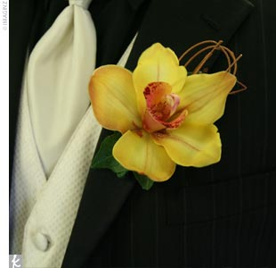 Charles' cool boutonniere, a bright yellow orchid, added a splash of color to his black ensemble.