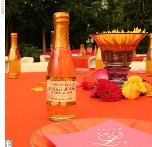 Amy and Charles gave out bottles of blackberry cabernet and white peach chardonnay to all of their guests as favors. They created the wine flavors at a local winery and personalized the bottles with wedding labels.