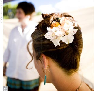 The bride styled her own hair in a French twist, accenting it with fresh alstroemeria.