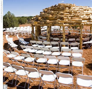 "Kasey and Jason knew from the beginning of their planning that they wanted to have a traditional Navajo ceremony, which meant building a Hogan, a traditional structure integral to the ceremony. The Hogan is a sacred home for the Diné (Navajo) people who practice traditional religion,"" explains Kasey. Kasey and Jason built their Hogan from the groun ..."