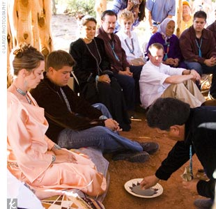 "The Navajo ceremony began with the bride and groom washing each other's hands, then eating white and yellow corn meal (symbolizing male and female), which the medicine man combined in a bowl and blessed. ""After the bride and groom eat the corn mush, the groom's family, one by one, will eat some as well,"" Kasey explains. ""If there is any left, the b ..."