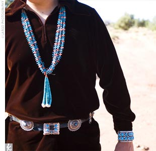 Jason and his four groomsmen wore traditional long-sleeved velveteen shirts which that were custom-made for them, the groom's in brown and his attendants' in black. Jason also wore a vintage Navajo cuff bracelet which that matched the bride's necklace, her wedding gift to him.