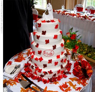 Laura and Brady's five-tiered cake was chocolate with white buttercream frosting. The decadent confection was decorated with handmade sugar leaves in fall colors and topped with a small white statue cake topper.