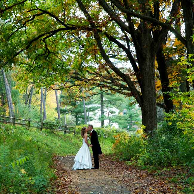 Following the ceremony, the bridal party and the couple were escorted in an old-fashioned trolley car named Hollie for photographs at Nichols Arboretum and Michigan Stadium in Ann Arbor.