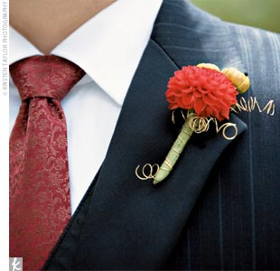Randy wore a small red dahlia boutonniere with his sharp ensemble -- a two-button, notch-lapel jacket with a black shadow stripe, matching trousers, a black Claiborne vest, and a red print, silk necktie by Pink Inc.