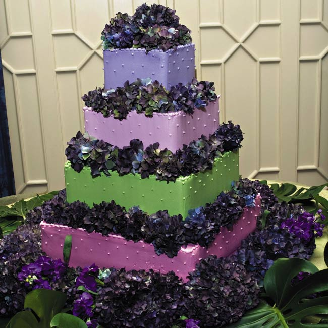 """We leafed through tons of pictures, and when we saw the pink, purple, and chartreuse cake, we knew it was the one we wanted. It looked and tasted wonderful,"" Michele says of the four-tiered square cake with dark purple hydrangeas."