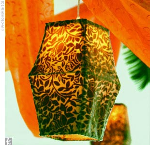 Sage-colored, velvet, Moroccan lanterns were hung from the ceiling of the tent along with fabrics in rich hues.