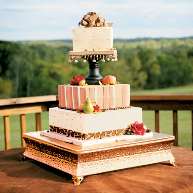 The three-tiered dark spice cake was flavored with pears, caramel sauce, and a truffle walnut.