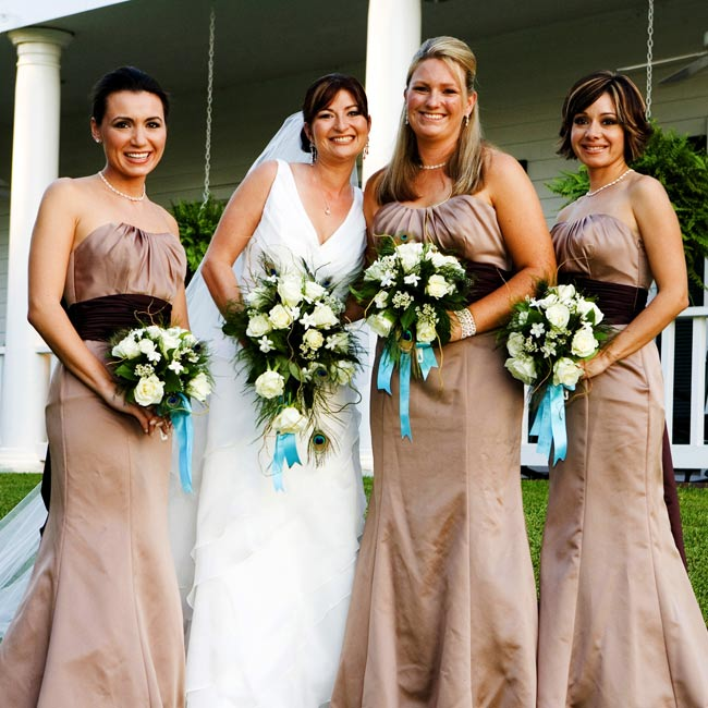 Delinah's three bridesmaids wore strapless chocolate-brown floor-length gowns with dark brown sashes at the waist.