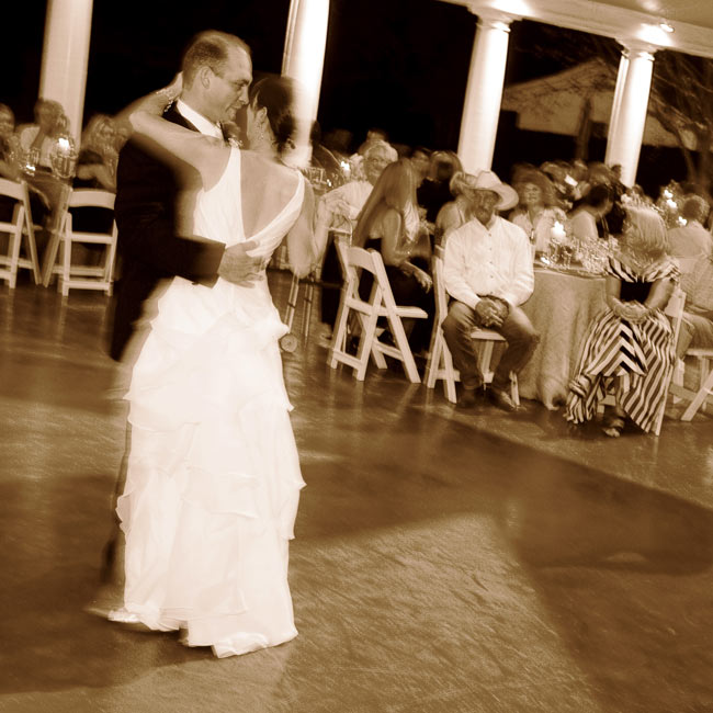 "Delinah and David shared their first dance to ""Wild Horses"" by the Rolling Stones. ""It was so long that my father cut in, and David asked my mother to dance!"" the bride remembers."