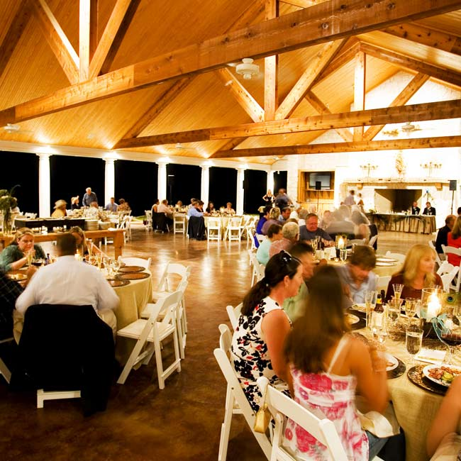 Delinah and David celebrated with their guests at a reception in the pavilion behind the ranch house, which is surrounded on two sides with white pillars and boasts two fireplaces.