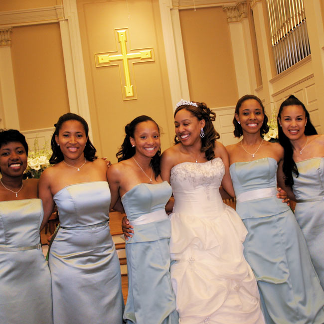 Toya's two maids of honor wore strapless satin dresses in celadon by Mackenzie Michaels, while her four bridesmaids wore floor-length belted dresses in celadon satin by Alfred Angelo.