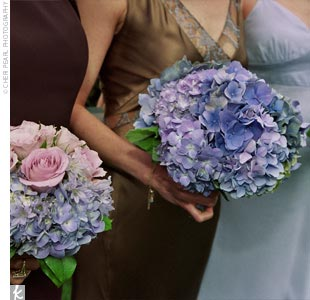 To complement the lace on her gown, Suzanne carried a periwinkle-colored hydrangea bouquet with greenery and lavender mixed in.