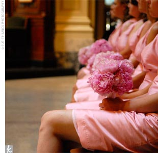 Jessica's six bridesmaids wore light pink, silk shantung dresses with an Empire waist and mock wrap neckline by Simple Silhouettes.
