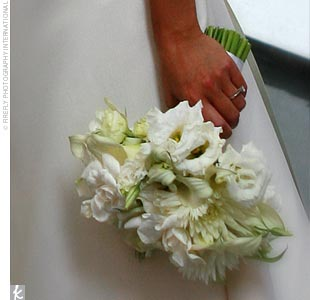Althea carried a contemporary, hand-tied bouquet of white flowers: lisianthuses, gardenias, miniature calla lilies, and dahlias.