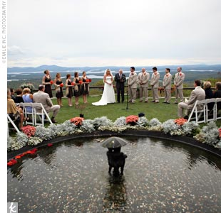 The ceremony was held in the Castle Garden, a semicircular space enclosed by a stone wall. Guests were treated to the breathtaking view of rolling hills and a crystal clear lake.