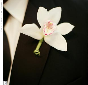 """The main flower I chose to be used in the bouquets, boutonnieres, and centerpieces was the orchid -- to honor John's Southeast Asian background,"" the bride explains."