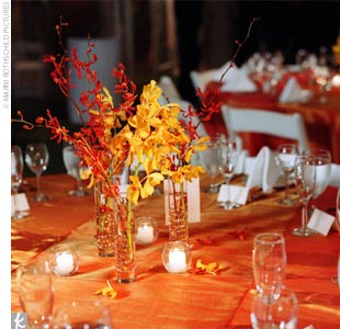 Vivid orange and yellow orchid centerpieces topped the tables at the reception.