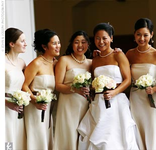 Mary's two maids of honor and three bridesmaids wore champagne-colored dresses from the Ann Taylor Celebrations collection, tied at the waist with the same brown satin ribbon used throughout the wedding decor.