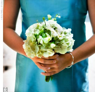The maids accented their Tiffany blue dresses with all-white bouquets of ranunculuses, hydrangeas, and lily of the valley.