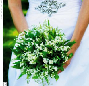 Julie kept her style classic with an elegant bouquet of lily of the valley.
