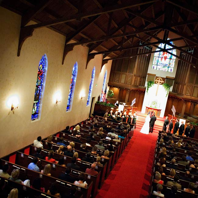 The couple married at a nondenominational church with gorgeous stained-glass windows.