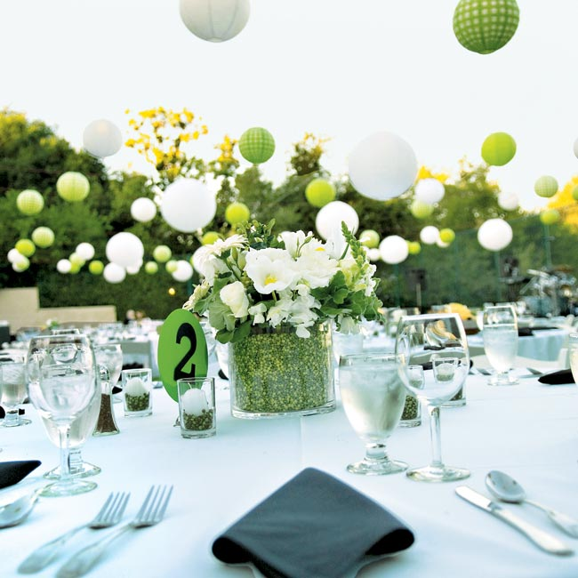 The centerpieces were unique and perfectly complemented the polka-dot color scheme. Some of the tables had bouquets of white flowers set in a cylinder of peas, while others had large pillar candles set in the peas.