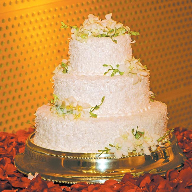 The cake was a three-tiered hazelnut cake with toasted coconut frosting.