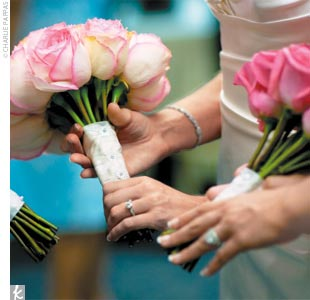 Jennifer's six bridesmaids carried bouquets of fuchsia roses. Instead of boutonnieres, the groomsmen wore fuchsia pocket squares that matched the bridesmaid bouquets.