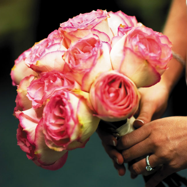 Jennifer's bouquet was made up of white Esperanza roses with pink tips.